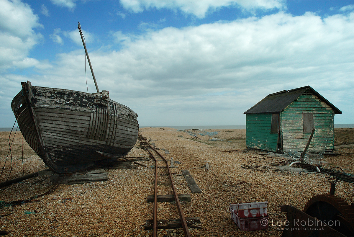 photograph by lee robinson of an abandoned boat and shed, Dungeness beach, Kent