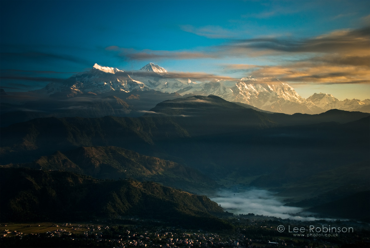 Landscape Photograph of the himalayas mountains with clouds at dawn by lee robinson
